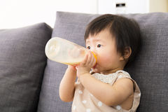 Asia baby girl having meal Royalty Free Stock Photos