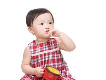 Asia baby girl holding snack box Royalty Free Stock Photos