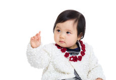 Asia baby girl looking at her finger Royalty Free Stock Images