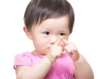 Asia baby girl looking at two finger touch together Stock Photography