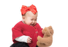 Asia baby girl play doll bear Royalty Free Stock Image