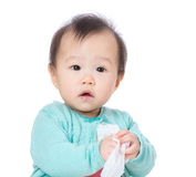 Asia baby girl play with tissue royalty free stock image
