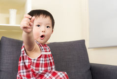 Asia baby girl point to you Royalty Free Stock Image
