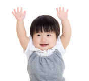 Asia baby girl raise hand. Isolated on white Royalty Free Stock Image