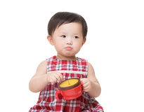 Asia baby girl with snack box Stock Photos