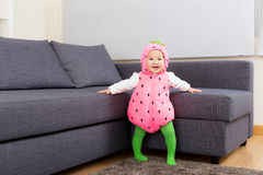 Asia baby girl with strawberry dressing Royalty Free Stock Image