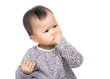 Asia baby girl suck finger into mouth Stock Image
