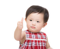 Asia baby girl with thumb up Stock Photos