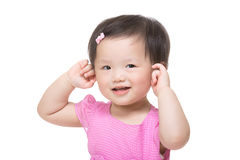 Asia baby girl touch her ear Stock Photo