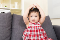 Asia baby girl touch her head Royalty Free Stock Photos