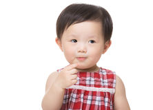 Asia baby girl touch her mouth Royalty Free Stock Image
