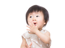 Asia baby girl touch her mouth Stock Photo