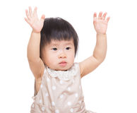 Asia baby girl two hands up Stock Images