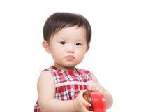 Asia baby holding food box stock photos