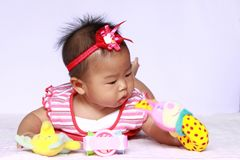 Asia baby playing toy. She is six month Royalty Free Stock Image