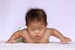 Asia baby will fly. Asia baby in action look like she will fly Royalty Free Stock Photography