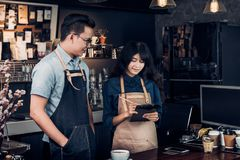 Asia Barista waiter take order from customer in coffee shop,cafe Royalty Free Stock Photos