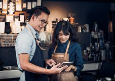 Asia Barista waiter take order from customer in coffee shop,cafe. Owner writing drink order at counter bar,Food and drink business concept,Service mind concept Royalty Free Stock Photo