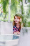 Asia beautiful girl sitting on white chair. Portrait of Asia beautiful girl sitting on white chair Royalty Free Stock Photo