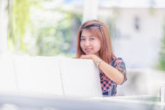 Asia beautiful girl sitting on white chair. Portrait of Asia beautiful girl sitting on white chair Royalty Free Stock Photography
