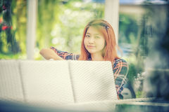 Asia beautiful girl sitting on white chair. Portrait of Asia beautiful girl sitting on white chair, vintage effect Royalty Free Stock Photos