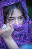 Asia beautiful lady covered in violet fabrics stock photography