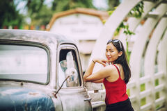 Asia beautiful lady standing near retro car Stock Images
