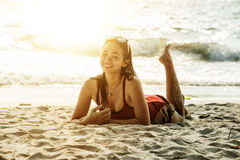 Asia beautiful woman lying on the beach. Portrait of asia beautiful woman lying on the beach stock photography