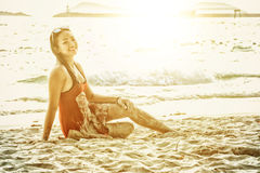 Asia beautiful woman sitting on the beach sand. Portrait of asia beautiful woman sitting on the beach sand stock photos