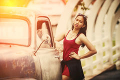 Asia beautiful woman standing near vintage truck Stock Photos
