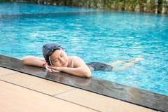 Asia beautiful woman in swimming pool. Asia beautiful woman at swimming pool stock photo
