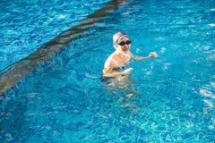 Asia beautiful woman in swimming pool. Asia beautiful woman relax in swimming pool stock image