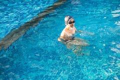 Asia beautiful woman in swimming pool. Asia beautiful woman at swimming pool royalty free stock image