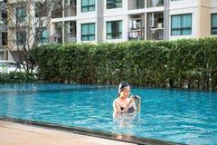 Asia beautiful woman in swimming pool. Asia beautiful woman at swimming pool royalty free stock photo