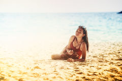Asia beautiful young girl lying on the sand. Portrait of Asia beautiful young girl lying on the sand royalty free stock photography