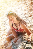 Asia beautiful young girl lying on the sand royalty free stock photography