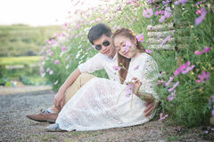 Asia Beautiful young loving couple in blossom spring garden. Royalty Free Stock Photo