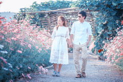 Asia Beautiful young loving couple in blossom spring garden. Stock Image