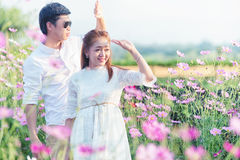 Asia Beautiful young loving couple in blossom spring garden. Stock Photos