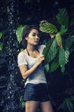 Asia beautiful young sexy woman posing on nature Royalty Free Stock Photo