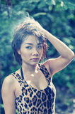 Asia beautiful young sexy woman posing on nature Royalty Free Stock Photography