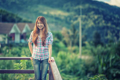 Asia beautiful young woman stand on view point royalty free stock photography