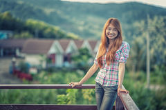 Asia beautiful young woman stand on view point stock images