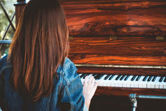 Asia beauty stylish woman playing a retro piano in free time royalty free stock image