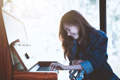 Asia beauty stylish woman playing a retro piano in free time. Candid shot in light nature Stock Photo
