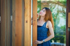 Asia beuatiful woman with door of coffee shop stock image