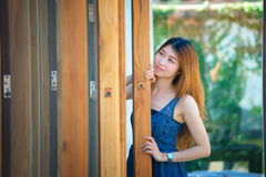 Asia beuatiful woman with door of coffee shop Stock Photography