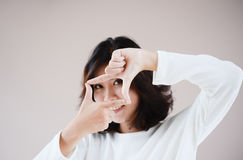 Asia beutiful girl make hand symbol frame Stock Photos