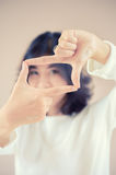 Asia beutiful girl make hand symbol frame Royalty Free Stock Photo