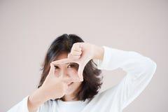 Asia beutiful girl make hand symbol frame Royalty Free Stock Photography